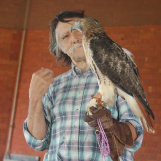 man holding bird of prey